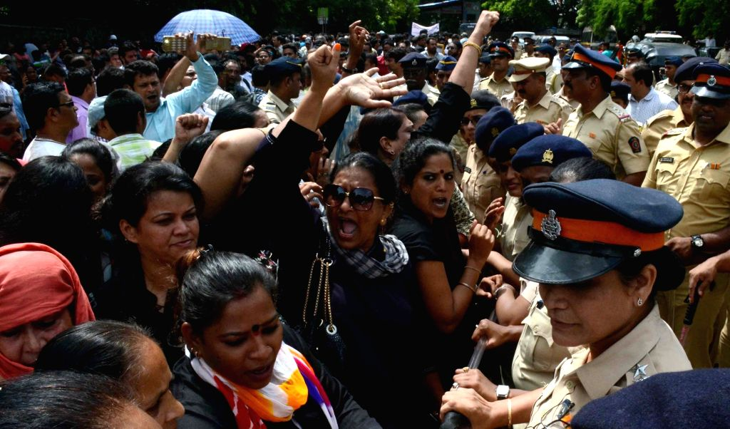 Federation of Western India Cine Employees (FWICE) union members stage a demonstration demanding an increment in the workers' salaries and an eight hour shift during an indefinite strike ...