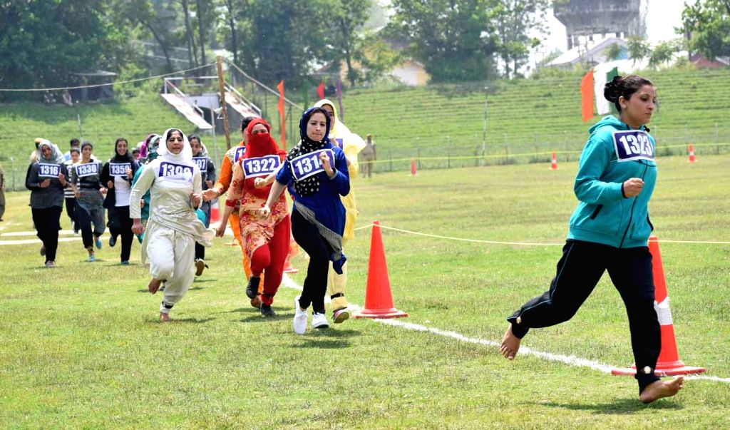 Female candidates participate during an Indian Army Recruitment drive at Bakshi Stadium in Srinagar on May 13, 2017.