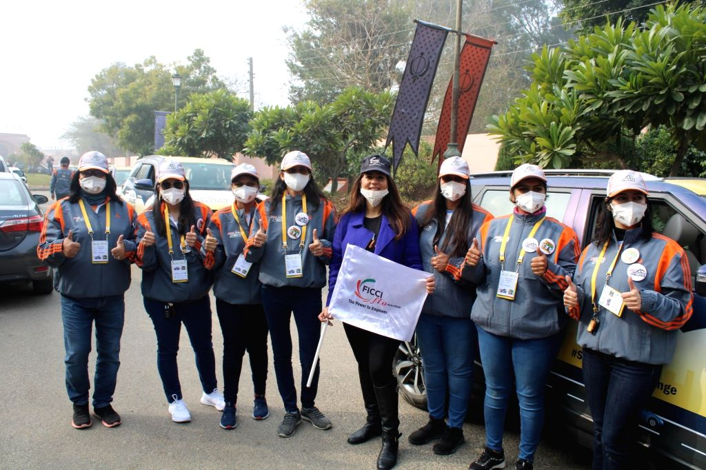 Female drivers pose for pictures before driving their cars along with other participants from Amritsar to Kanyakumari during the 'India Against Road Crash' awareness campaign, in Amritsar ...