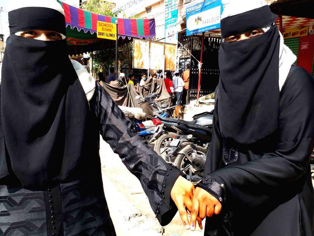 Female Muslim voters show their inked fingers after casting their votes for Greater Hyderabad Municipal Corporation (GHMC) elections, on Dec 1, 2020.