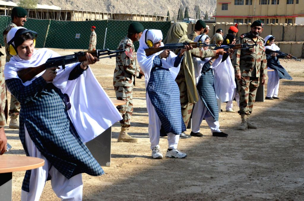 Female students hold guns during a weapon training session in southwest Pakistan's Quetta, Oct. 17, 2015. Authorities have commenced special weapon training sessions ...
