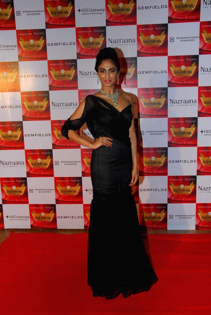 Femina Miss India Pune 2013 Deepti sati during the 10th Annual Gemfields and Nazraana Retail Jeweller India Awards 2014 in Mumbai on July 19, 2014. (Photo : IANS)