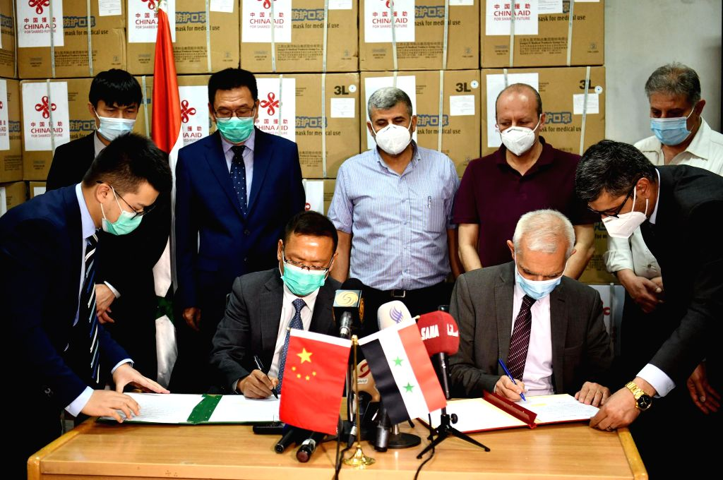 Feng Biao (2nd L, Front), Chinese ambassador to Syria, and Ahmad Khleifawi (2nd R, Front), the assistant health minister of Syria, attend a handover ceremony in ...