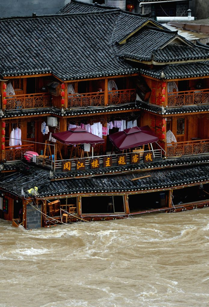 Photo taken on July 16, 2014 shows the flooded buildings in the historical town of Fenghuang, central China's Hunan province. Continuous rain has flooded the ...