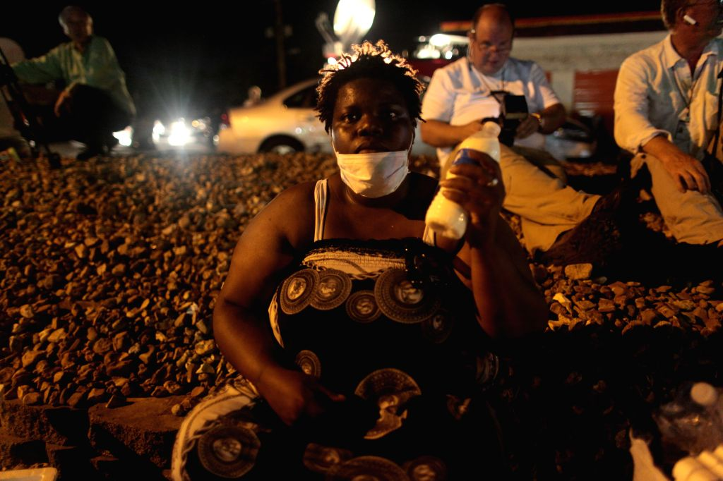 Jamela White holds a bottle of milk that she used to help a men who was pepper sprayed by police in Ferguson, the United States, Aug. 20, 2014. Police shot and ...