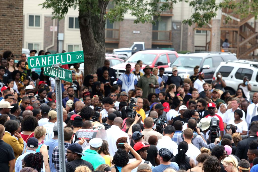 FERGUSON, August 10 Protestors gather at the Michael Brown memorial in Ferguson, Missouri, U.S., on August 9, 2015. Several hundred people gathered in Ferguson on Sunday to mark the ...