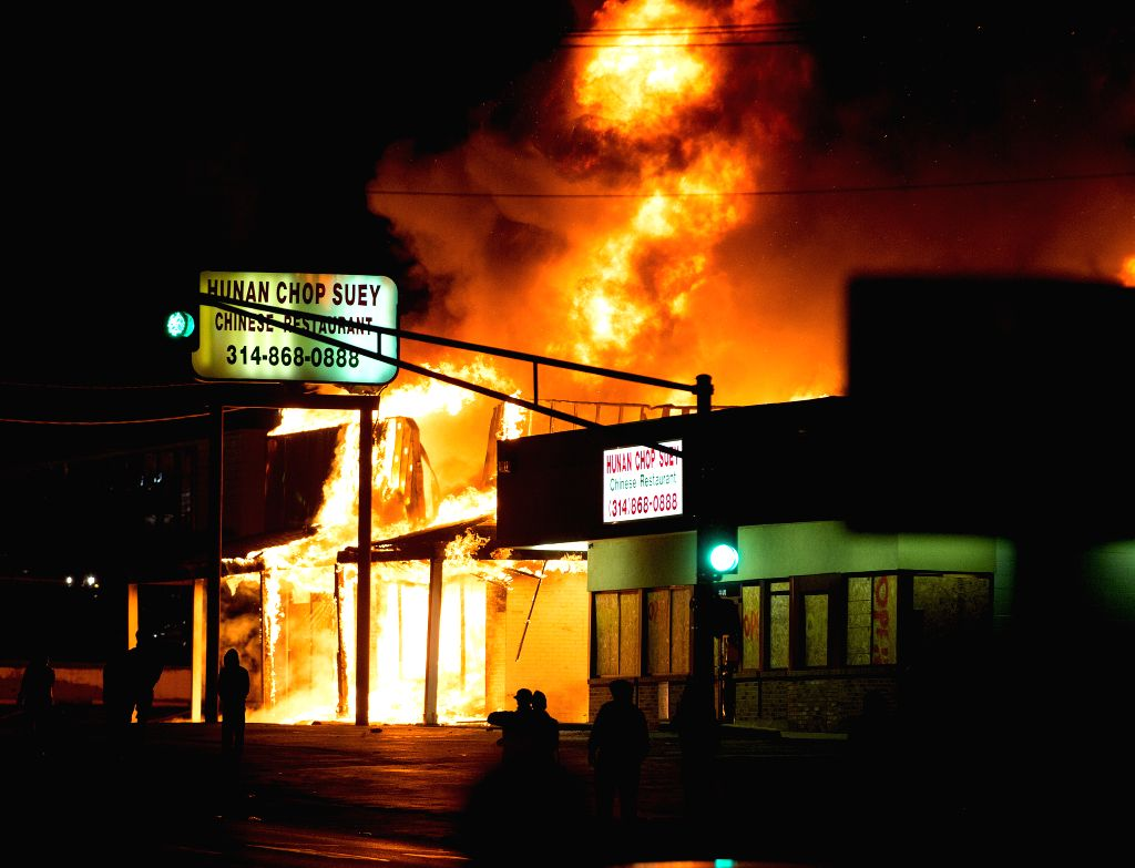 Ferguson (U.S.):  A local business is burned in the fire set by demonstrators in Ferguson, Missouri, the United States on Nov 25, 2014. Violence erupted Monday night in Ferguson after the ...