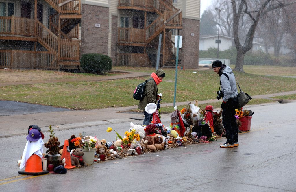 Ferguson (United States): Journalists take photos at the scene where Michael Brown was shot in Ferguson, St. Louis County, Missouri, the United States, Nov. 26, 2014. Ferguson faces unrest as ...