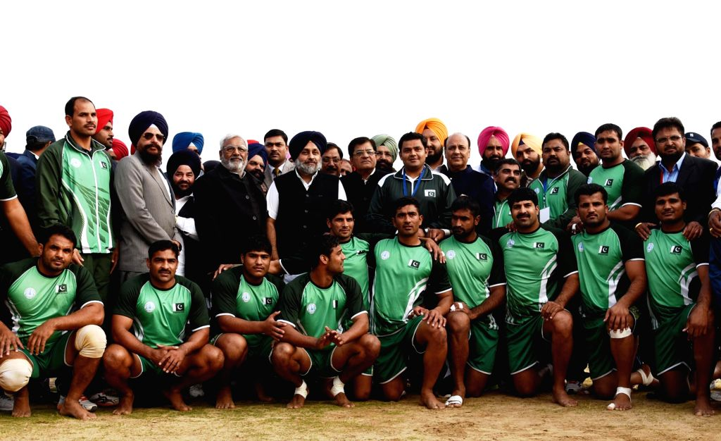 Punjab Deputy Chief Minister Sukhbir Singh Badal poses for a group photo with the members Pakistani Kabaddi team during the 5th World Cup Kabaddi match between Pakistan and Sweden at ...