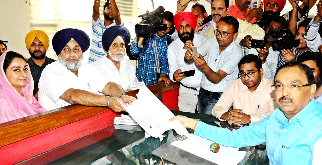 Ferozepur: Shiromani Akali Dal (SAD) President and the party's Lok Sabha candidate from Ferozepur, Sukhbir Singh Badal accompanied by his wife and Union Minister Harsimrat Kaur Badal, files his nomination for the 2019 Lok Sabha elections in Punjab's  - Harsimrat Kaur Badal and Sukhbir Singh Badal
