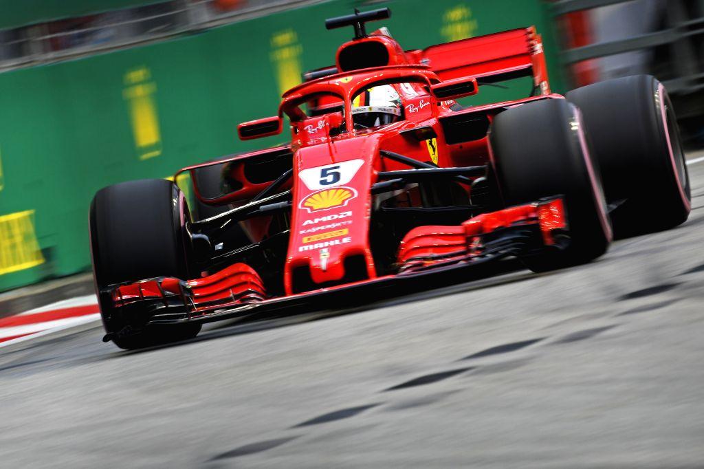 Ferrari's driver Sebastian Vettel. (Xinhua/Then Chih Wey/IANS)