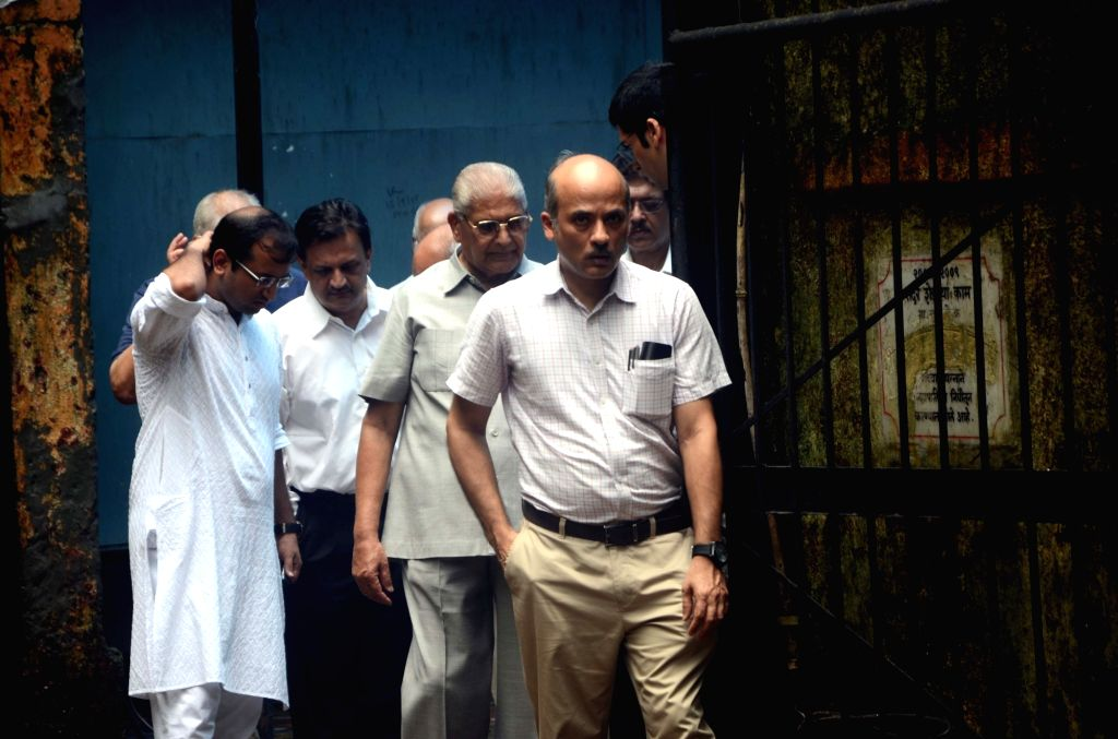 Ffilmmaker Sooraj Barjatya arrives at last rites of Rajshri Media MD and CEO Rajjat Barjatya who passes away after losing a battle to cancer at Worli Crematorium in Mumbai on July 30, 2016.