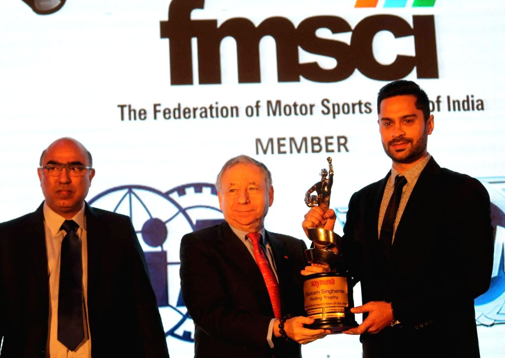 FIA president Jean Todt presents award to Indian race car driver Gaurav Gill during the Federation of Motor Sports Clubs of India (FMSCI) awards ceremony in Hyderabad on Feb 3, 2017.