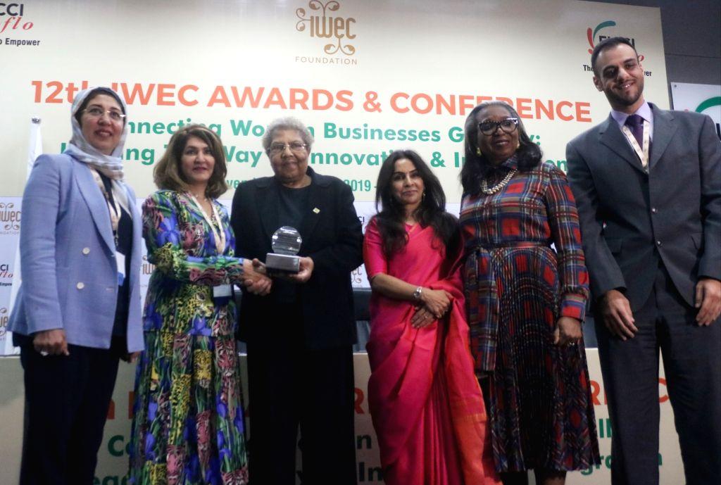 FICCI Ladies Organisation (FLO) President Harjinder Kaur Talwar with foreign delegates at 12th IWEC Awards and Conference in New Delhi on Nov 12, 2019. - Harjinder Kaur Talwar