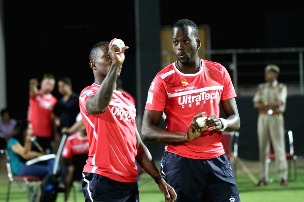 Fidel Edwards and Kevon Cooper during a night practice match at Sawai Mansingh Stadium in Jaipur on March 31, 2013.