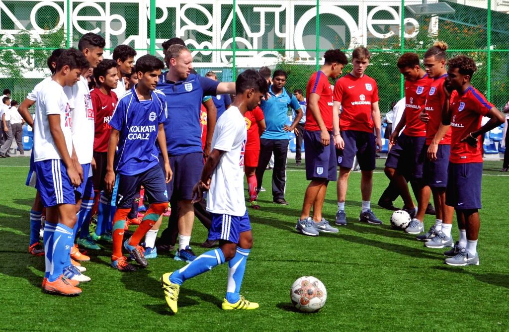FIFA U-17 England coach Steve Cooper along with English players Jadon Sancho, Angel Gomes, Joel Latibeaudiere interact with school students at New Town in Kolkata on Oct 12, 2017.