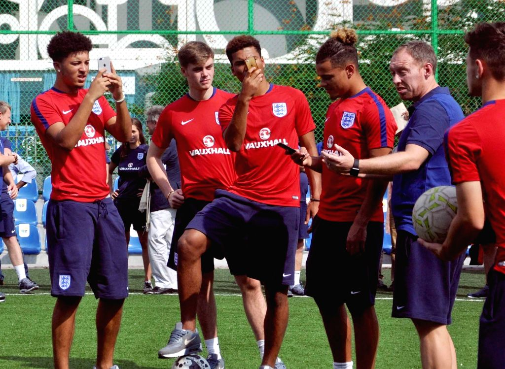 FIFA U-17 England coach Steve Cooper along with English players Jadon Sancho, Angel Gomes, Joel Latibeaudiere at New Town in Kolkata on Oct 12, 2017.
