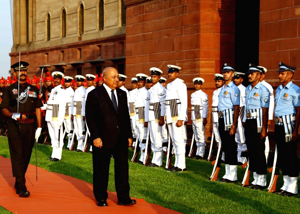Fiji's Minister of Defence and National Security, Ratu Inoke Kubuabola reviews the Tri-Services Guard of Honour on the lawns of South Block in New Delhi on May 29, 2017.