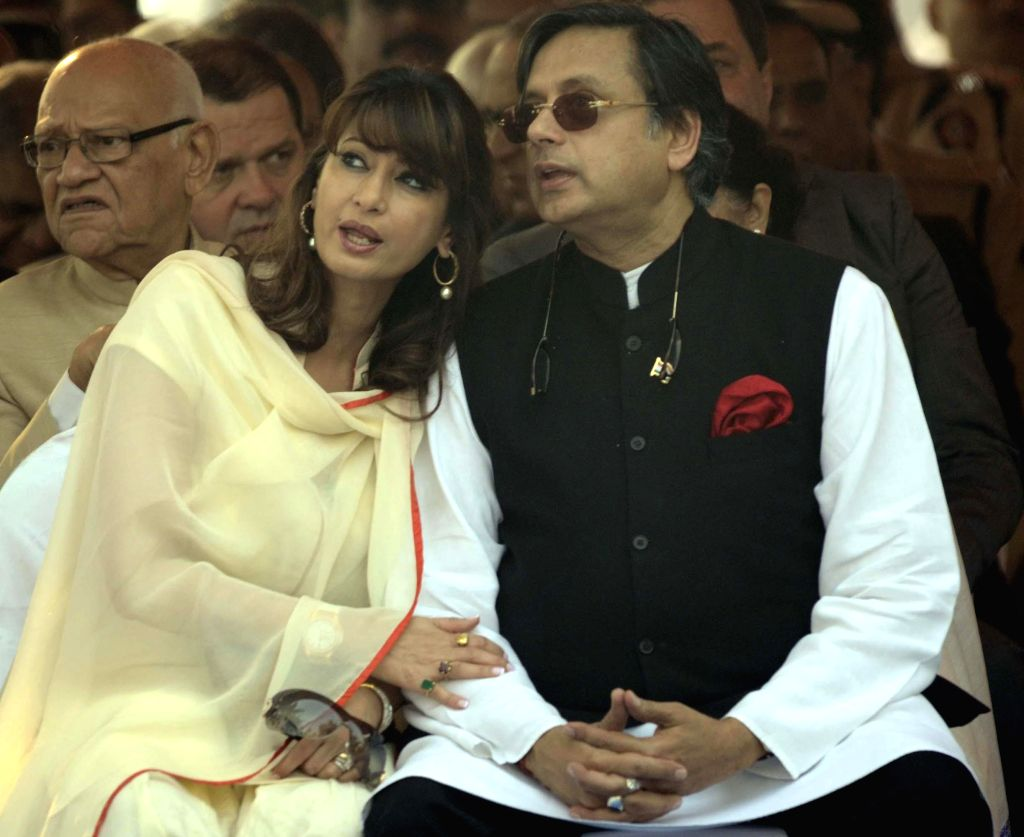 File Photo of Union Minister of State for Human Resource Development Shashi Tharoor and his wife Sunanda Pushkar during an event. The minister was in news after tweets posted on his verified account, got twitterati all abuzz due to the very personal  - Shashi Tharoor