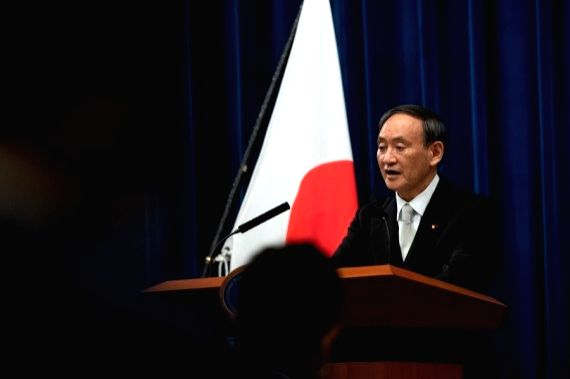 File photo shows that Yoshihide Suga, Japan's new prime minister, speaks during a press conference in Tokyo, Japan .