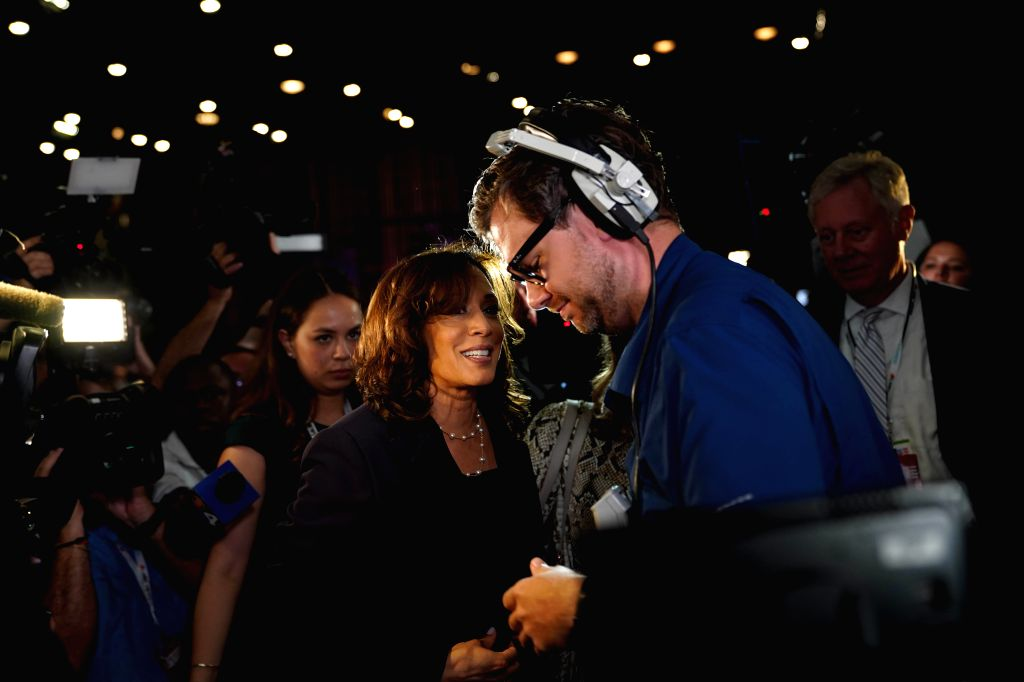 File photo taken on June 27, 2019 shows Senator Kamala Harris (C-L) of California interviewed after the second night of the first Democratic primary debate in ...