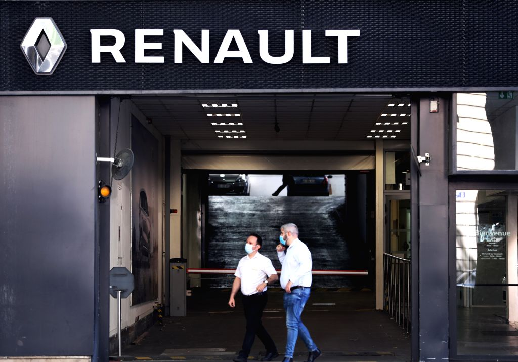 File photo taken on May 29, 2020 shows people walking out of a French automaker Renault's dealer shop in Paris, France. Renault released its financial results for the ...