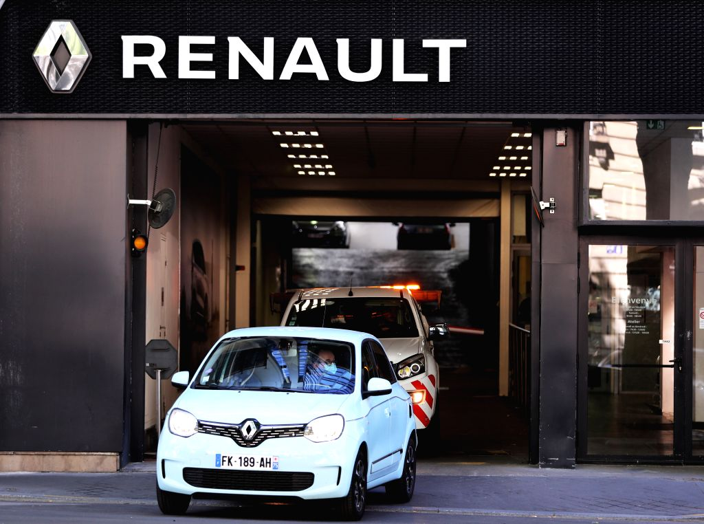 File photo taken on May 29, 2020 shows vehicles running from a French automaker Renault's dealer shop in Paris, France. Renault released its financial results for the ...
