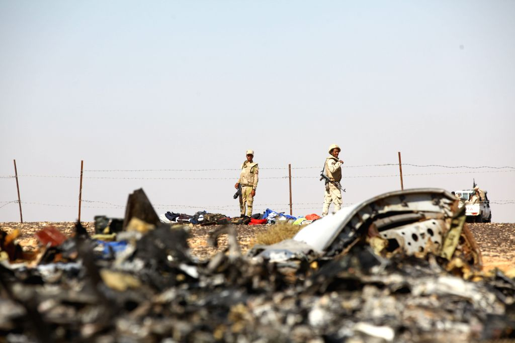 File photo taken on Nov. 1, 2015 shows soldiers stand guard at the crash site of a Russian passenger plane at the Hassana area, north Egypt. Russian Federal ...