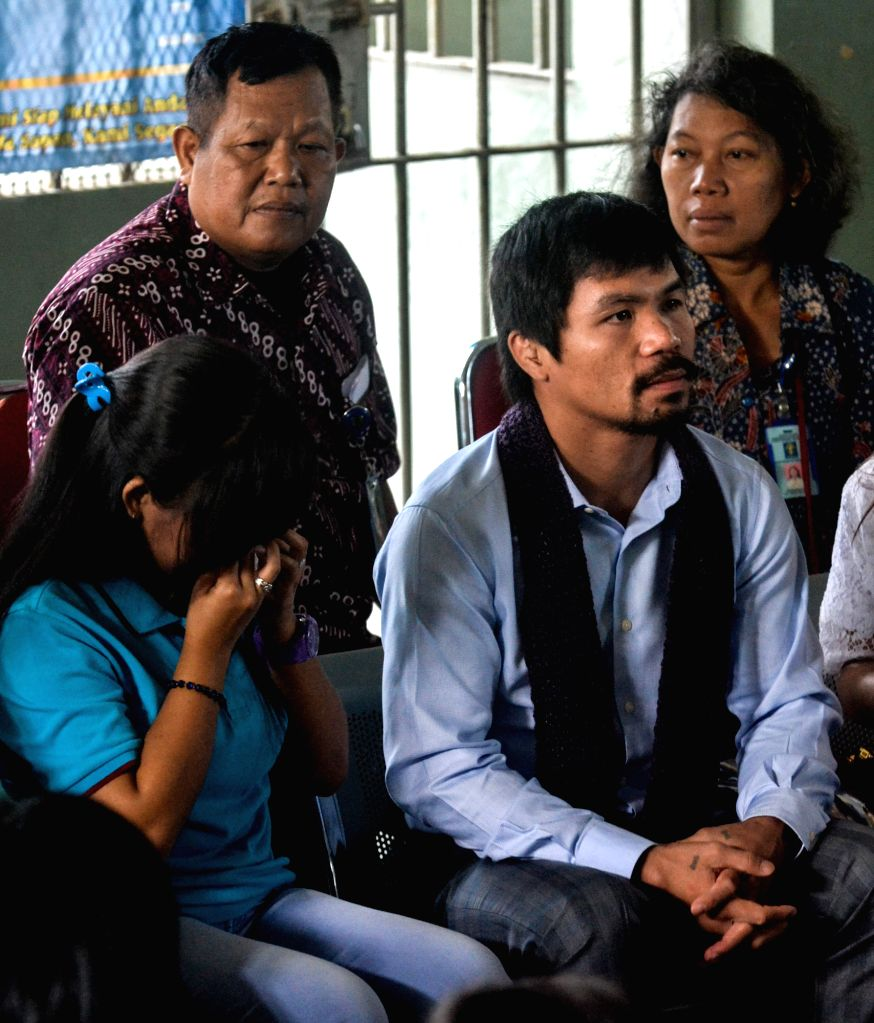 Filipino boxing icon Manny Pacquiao (R, front) visits Filipino death row prisoner Mary Jane Veloso (L, Front) at Wirogunan prison in Yogyakarta, Indonesia, July ...