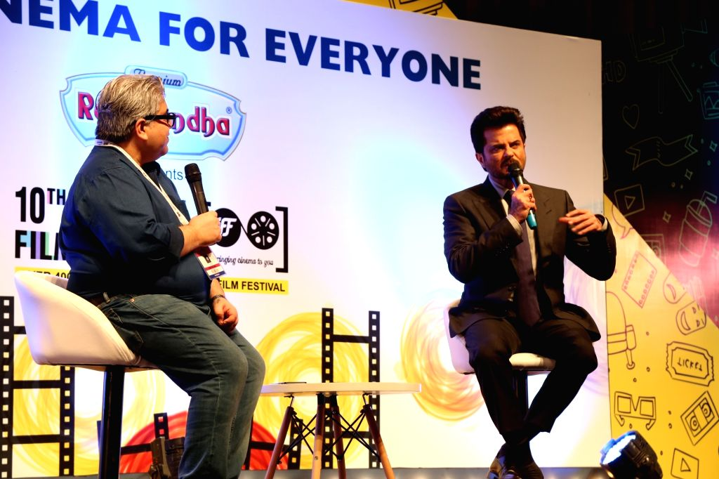 Film critic Rajeev Masand with actor Anil Kapoor during the inauguration of the 10th Jagran Film Festival (JFF) in New Delhi on July 18, 2019. - Anil Kapoor