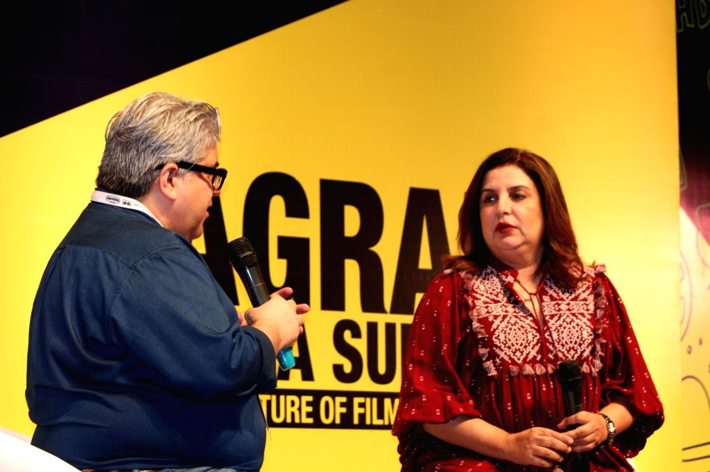 Film critic Rajeev Masand with producer Farah Khan during the inauguration of the 10th Jagran Film Festival (JFF) in New Delhi on July 18, 2019. - Farah Khan
