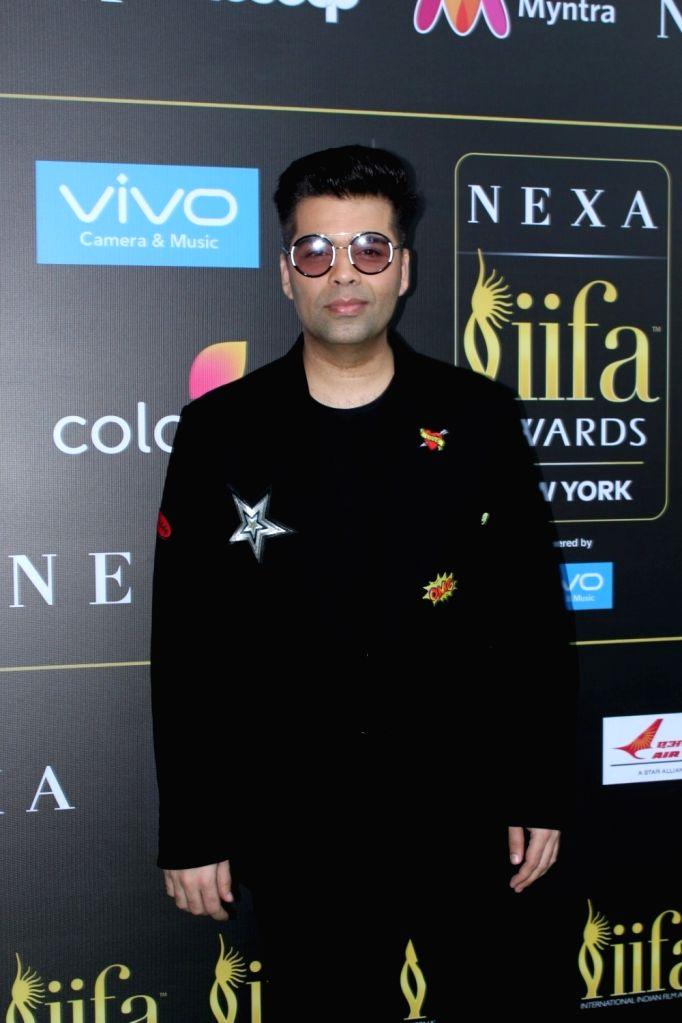 Film director Karan Johar during the press conference of 18th International Indian Film Academy (IIFA) awards in Mumbai, on June 18, 2017. - Karan Johar