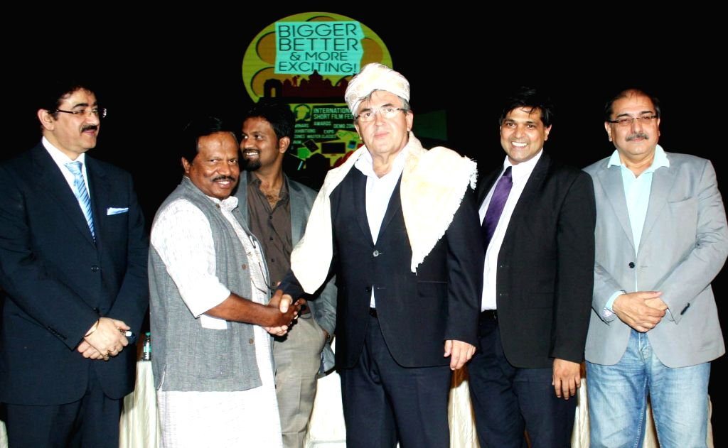 Film Director T S Nagabharana felicitate Ambassador of Bosnia and Herzegovina to India, Sabit Subasic during the 3rd Rolling Frames Film Summit 2015 in Bengaluru, on Oct 24, 2015.