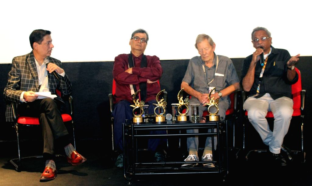 Film Directors Subhash Ghai and Shaji N. Karun, Critic Derek Malcolm and Taran Adarsh during an interactive session on ???The Evolution of Indian Cinema in the last 50 years??? at the 50th ...