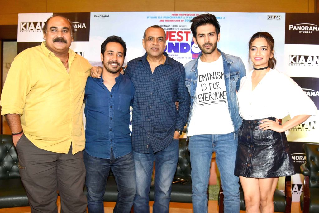 "Film Producer Abhishek Pathak (2nd L) with actors Paresh Rawal (C), Kartik Aaryan (2nd R) and Kriti Kharbanda (R) during a programme organised to promote their upcoming film ""Guest ... - Paresh Rawal and Producer Abhishek Pathak"