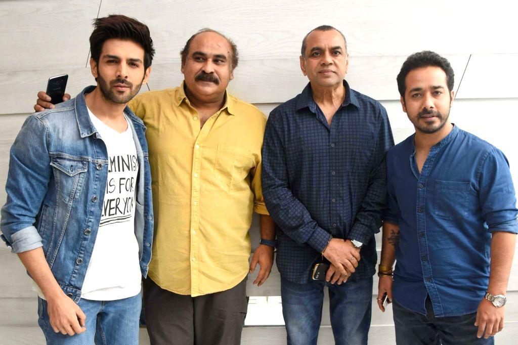 "Film Producer Abhishek Pathak with actors Kartik Aaryan and Paresh Rawal during a programme organised to promote his upcoming film ""Guest Iin London"" in New Delhi, on July 5, ... - Kartik Aaryan, Paresh Rawal and Producer Abhishek Pathak"
