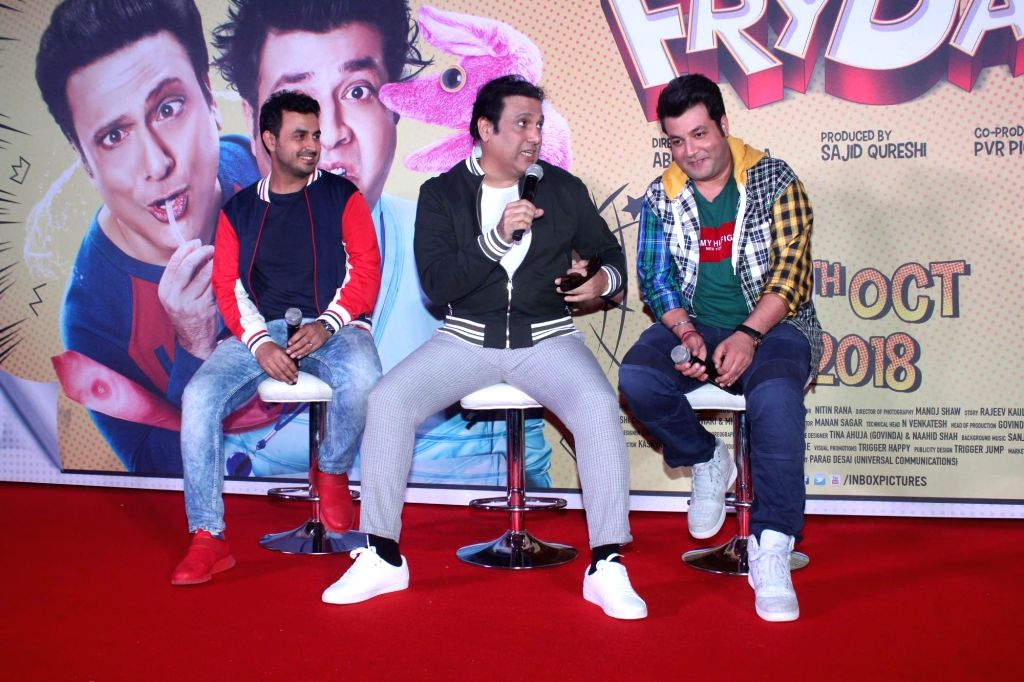 """Filmmaker Abhishek Dogra and actors Govinda and Varun Sharma during the trailer launch of their upcoming film """"FryDay"""" in Mumbai on Sept 8, 2018. - Abhishek Dogra, Govinda and Varun Sharma"""