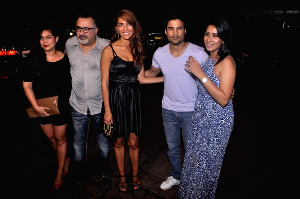 Filmmaker Ajay Chabbria, actor Rajeev Khandelwal and Italian actor Caterina Murino during the film Fever party in Mumbai on July 26, 2016. - Ajay Chabbria