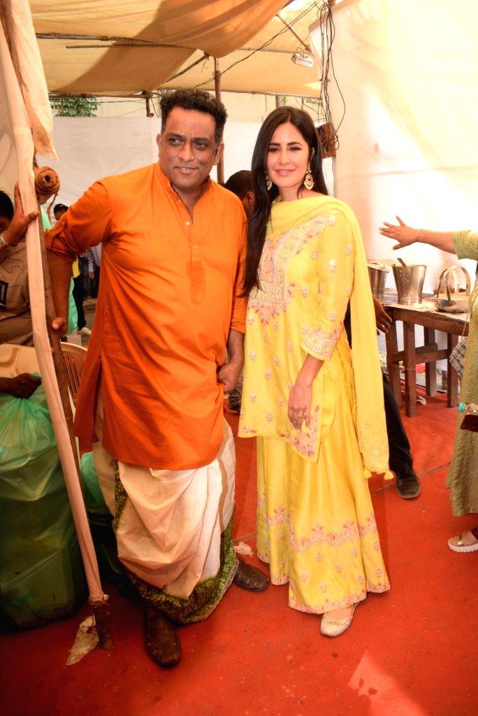Filmmaker Anurag Basu with actress Katrina Kaif during Saraswati Puja at his house in Mumbai on Feb 10, 2019. - Anurag Basu and Katrina Kaif