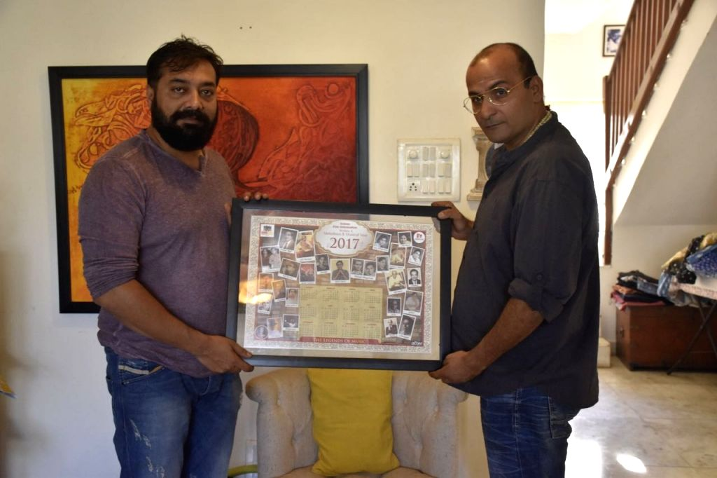 Filmmaker Anurag Kashyap and producer Sunil Bohra launch India Film Information's 10th edition film calendar that features exclusive and never seen before pictures of legendary Indian film ... - Anurag Kashyap and Kishore Kumar
