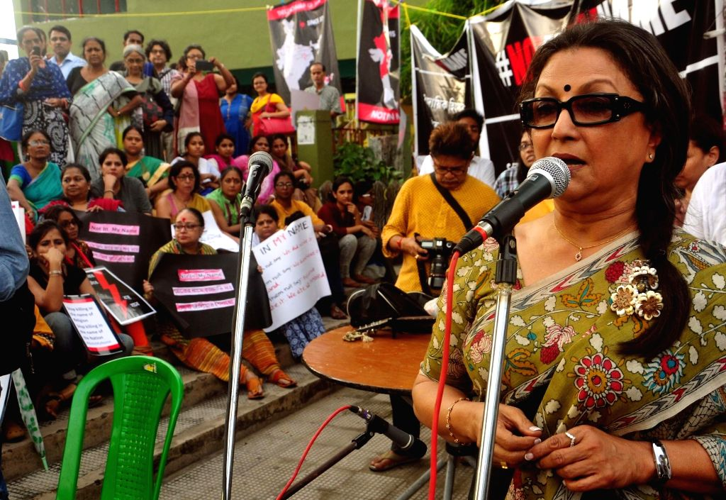 "Filmmaker Aparna Sen addresses during ""Not In My Name"" protest organised against killing of Junaid Khan, who was stabbed to death by a mob who accused him and his three companions ... - Aparna Sen and Junaid Khan"