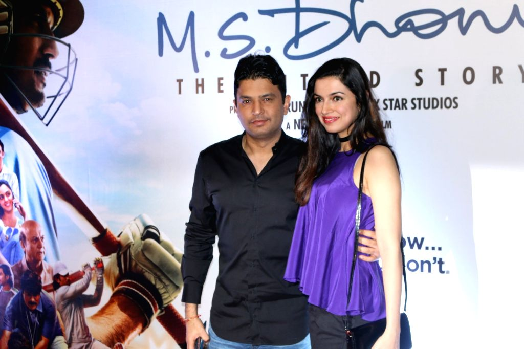 Filmmaker Bhushan Kumar with his wife and filmmaker Divya Khosla Kumar during the screening of film M S Dhoni, in Mumbai, on Sept 29, 2016. - Bhushan Kumar and Divya Khosla Kumar