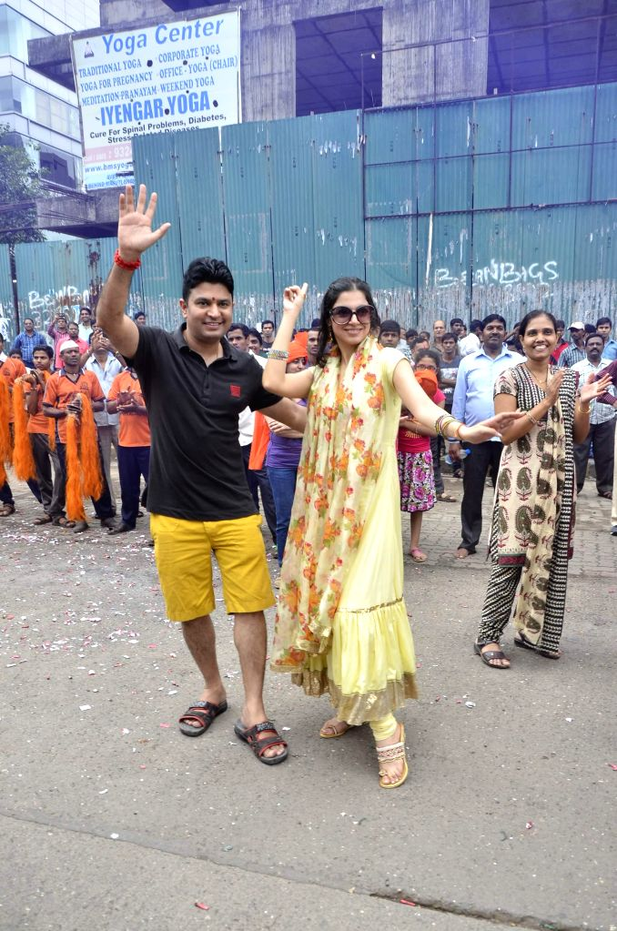 Filmmaker Bhushan Kumar with his wife Divya Khosla participate during the procession on the last day of Ganesh Chaturti festival in Mumbai on September 8, 2014.