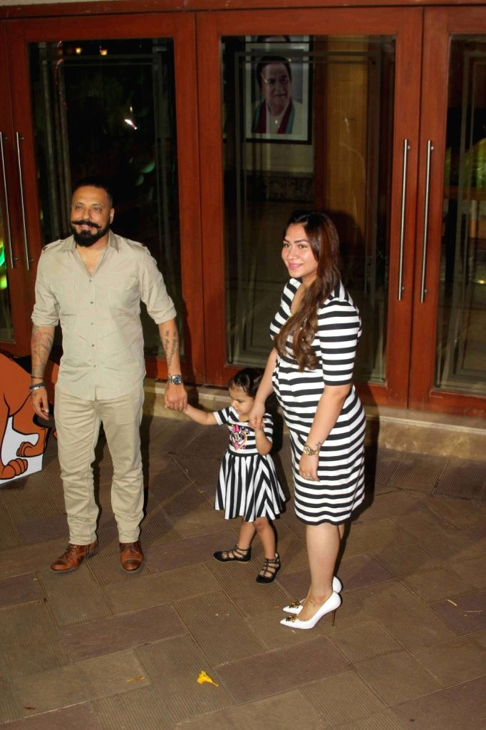 Filmmaker Bunty Walia with wife and kid arrive for Sanjay Dutt's children Iqra Dutt and Shahraan Dutt 6th birthday celebrations in Mumbai on Oct 21, 2016. - Bunty Walia, Sanjay Dutt, Iqra Dutt and Shahraan Dutt