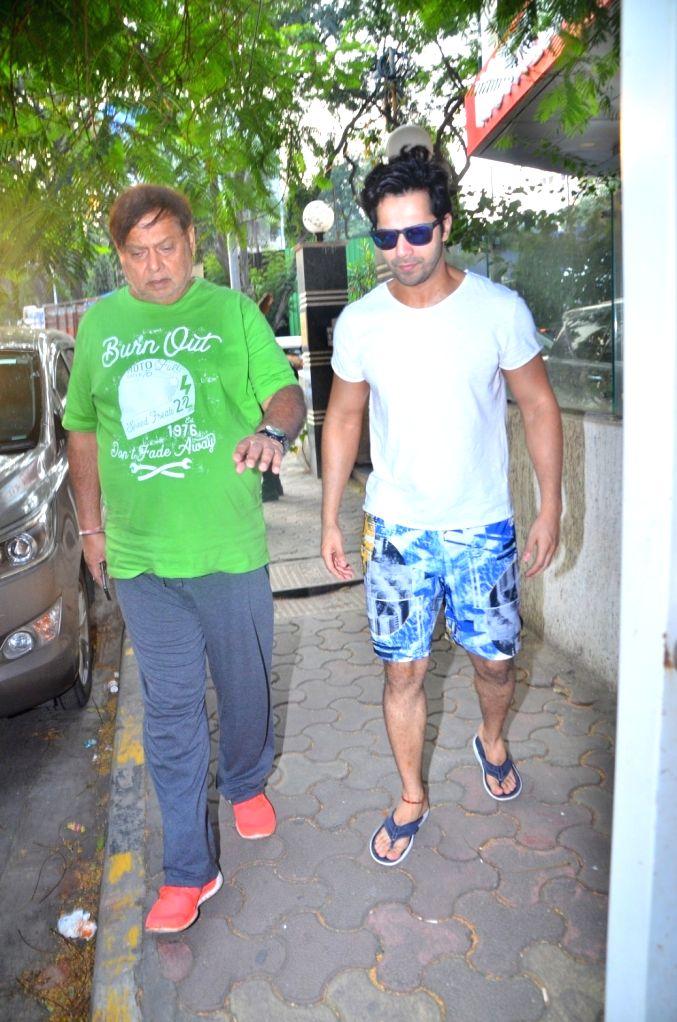 Filmmaker David Dhawan  and his son and actor Varun Dhawan seen at Juhu in Mumbai, on Oct 16, 2019. - David Dhawan
