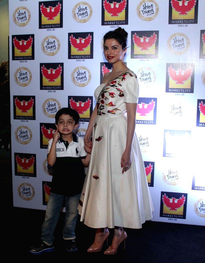 Filmmaker Divya Khosla Kumar with her son Ruhaan Kumar during the Shine Young 2016 -A talent platform for kids, in Mumbai, on Nov 13, 2016. - Divya Khosla Kumar and Ruhaan Kumar
