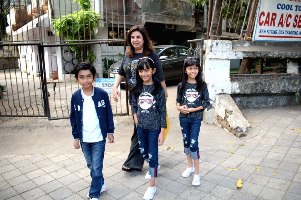 Filmmaker Farah Khan seen with daughters Diva and Anya Kunder along with son Czar Kunder at a salon in Mumbai on Feb 10, 2018. - Farah Khan