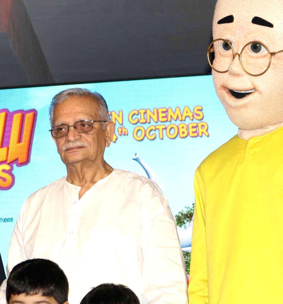 Filmmaker Gulzar with school children during the music launch of 3D animation film Motu Patlu King Of Kings, in Mumbai, on Oct 4, 2016. - Gulzar