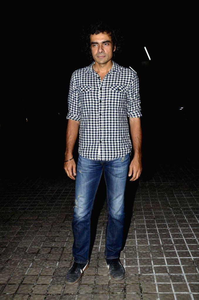 Filmmaker Imtiaz Ali during the screening of the film Katiyabaaz in Mumbai, on Aug. 20, 2014. - Imtiaz Ali