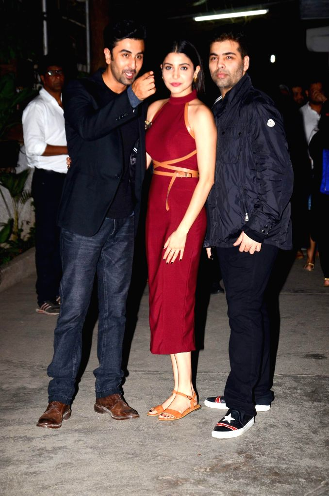 Filmmaker Karan Johar, actress Anushka Sharma and actor Ranbir Singh during the special screening of the movie `Bombay Velvet` on Anushka Sharma`s B`day in Mumbai on 1st May, 2015. Film Bombay Velvet ... - Karan Johar and Ranbir Singh